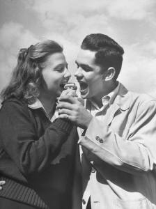 Boy and girl eating an ice cream cone together
